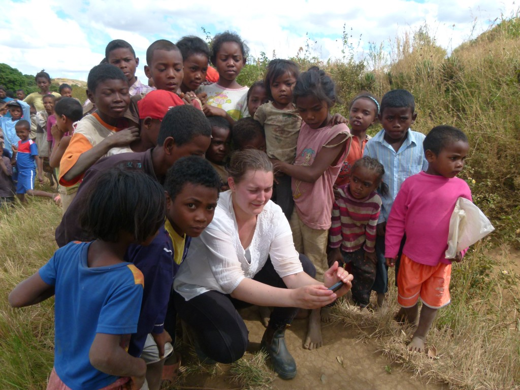 Nathalie sharing her photographs with local children