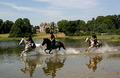 Cantering through the lake outside Castle Leslie