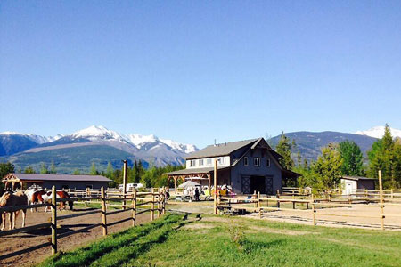 Ranch and facilities with snowy mountains