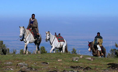 Oromo people riding on the Sanetti Plateau in Ethiopia