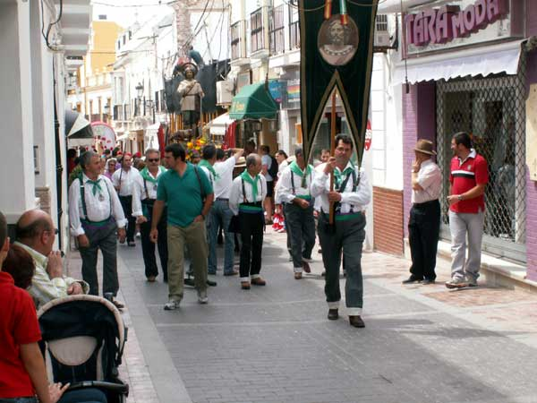 Foot parade through village streets