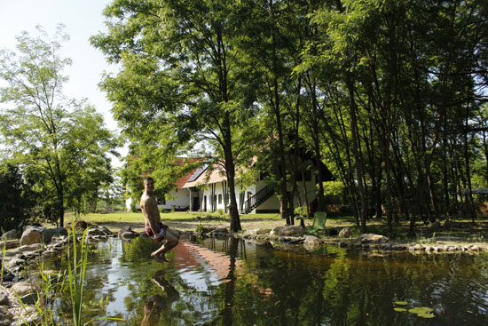 The farmhouse and swimming pond