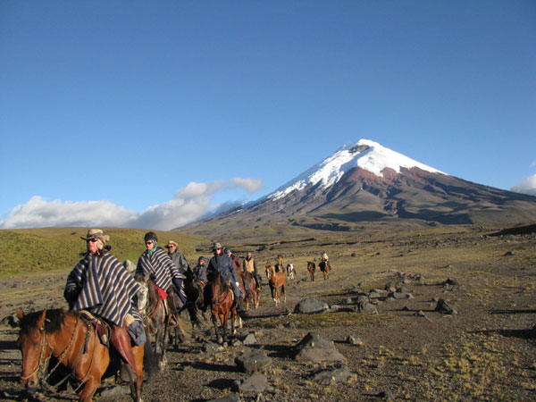 Riding around Cotopaxi volcano on a winter morning