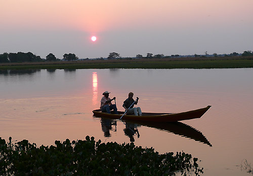 Canoeing at sunset in the Pantanal, Brazil
