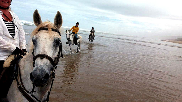 In the water! Riding in Morocco