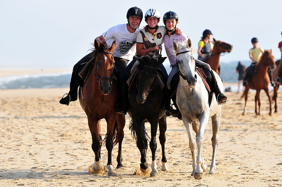 3 friends riding on the beach in France