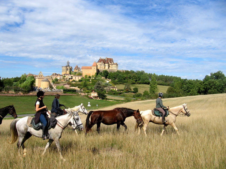 beautiful view of riding past a fortified town in Aquitane