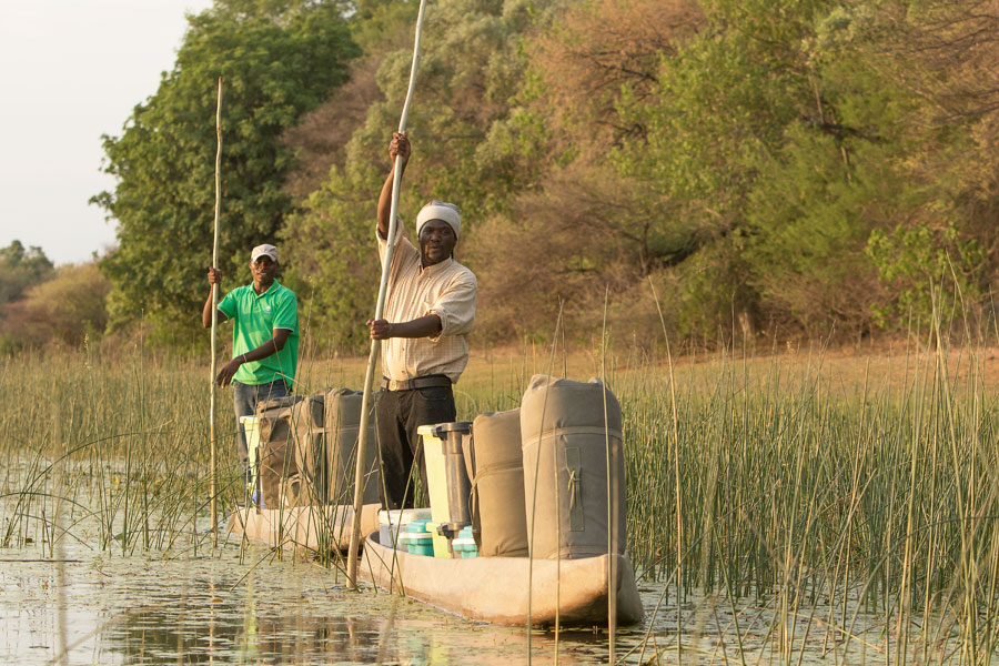 Mokoros with provisions being piloted in the Okavango Delta