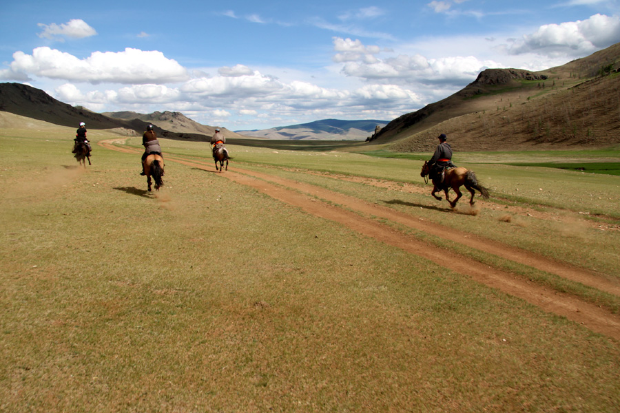 cantering across mongolian plains