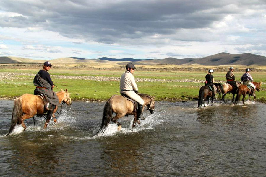 crossing rivers on horseback in Mongolia