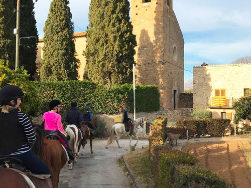 Riding through villages in Catalonia