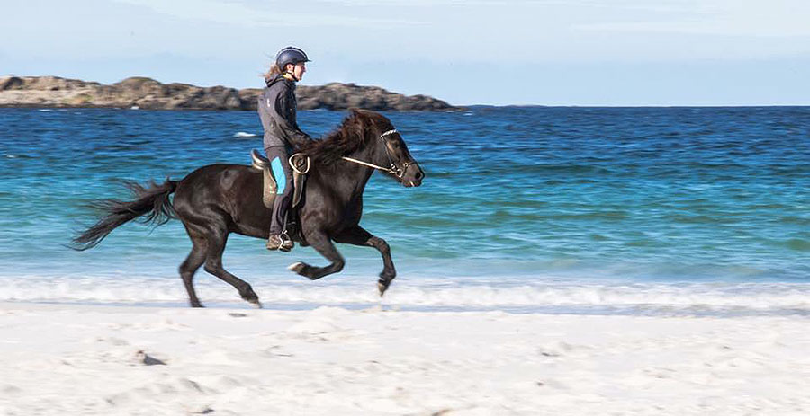 Riding on the beach