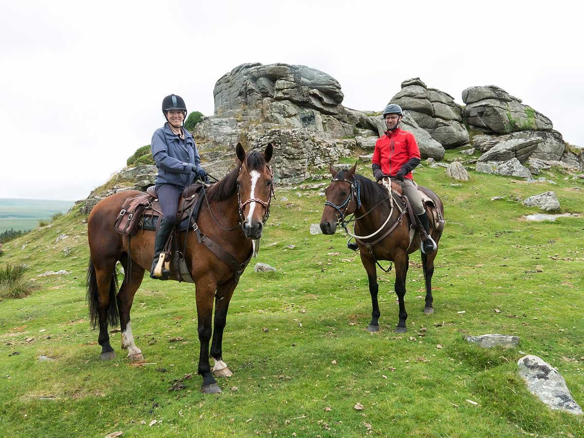 Posing alonside a tor on Dartmoor horse tour